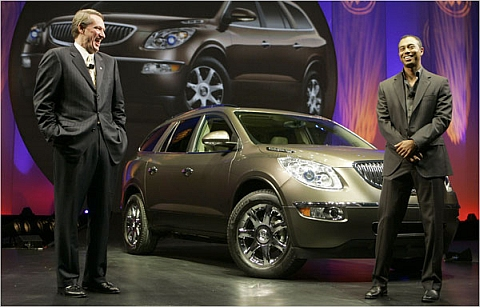"""""""You know Rick, I'm never going to drive this..."""" Tiger Woods stands with GM CEO Rick Wagoner in 2006."""